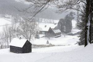 Three Barns in Flying Snow